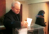 President Miloshevic at a polling station. Belgrade, Serbia. 2000 - Andrija Ilic - 2000,2000s,activist,activists,Balkan,balkans,CAMPAIGNING,CAMPAIGNS,conflict,conflicts,democracy,DEMONSTRATION,demonstrations,europe,male,man,men,people,person,persons,POL,political,POLITICIAN,politici