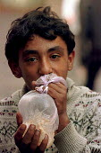 A Roma boy inhaling glue as a drug from a bag in central Belgrade,Serbia. 1997 - Andrija Ilic - .,1990s,1997,BALKAN,balkans,BAME,BAMEs,BME,bmes,child,CHILDHOOD,children,diversity,drug,drugs,ethnic,ethnicity,eu,europe,european,europeans,former,gipsey,Gipsey Gipsy Gypsey,Gipsies,Gipsy,gypse,gypsey