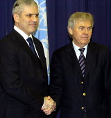 Serb President Boris Tadic on left shakes hands with the chief UN administrator for the Kosovo province, Soren Jessen Petersen, as they met in Pristina. President Tadic is the first Serbian head of st... - Andrija Ilic - 2000s,2005,administrator,Balkan,balkans,conflict,conflicts,eu,europe,european,europeans,former,hands,kosova,KOSOVAN,KOSOVARS,kosovo,male,man,men,nations,people,person,persons,POL,political,POLITICIAN,