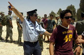 Israeli police prevent Israeli settlers opposing withdrawal from Gaza going into the Gush Katif Area to protest. Gaza 2005 - Andrija Ilic - 19-07-2005