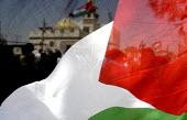 A Palestinian flag at a joint protest by Israeli, Palestinian and international peace activist against the controversial Israeli barrier wall in the West Bank village of Bilin, West Bank 2005 - Andrija Ilic - 11-07-2005