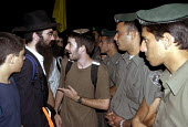 Israeli security forces try to prevent Jewish demonstrators - opponents of Israeli withdrawal from Gaza - going to Gush Katif settlement in Gaza. 2005 - Andrija Ilic - 19-07-2005