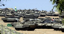 Israeli tanks amassed a few kilometres out side Gaza Strip during the evacuation of Israeli settlers from Jewish settlements in Gaza. Israel 2005 - Andrija Ilic - 17-08-2005