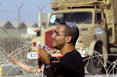 Israeli security forces evacuate Israeli settlers, many of whom resisted being removed, from the Jewish settlements at Gush Katif settlement, Kisufim, Gaza 2005 - Andrija Ilic - 16-08-2005
