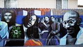 Mural painting in South-Central Los Angeles with characters such as Che Guevara, Martin Luther King and Gandi depicted on the mural. Los Angeles, USA 2003 - Andrija Ilic - 2000s,2003,ACE,African American,African Americans,america,Amerindian,Amerindians,art,arts,artwork,artworks,BAME,BAMEs,black,BME,bmes,cities,city,culture,diversity,ethnic,ethnicity,india,indian,latin,L