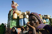 Chadian Red Cross assist Sudanese refugees who have fled attacks by Government supported forces in the Darfur region to go to UNHCR camps in Eastern Chad. 2004 The provision of clean drinking water pr... - Boris Heger - 01-09-2004