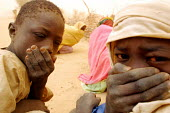 Sudanese refugees in a sand storm having fled attacks by Government supported forces in the Darfur region to go to UNHCR camps in Eastern Chad. 2004 - Boris Heger - 01-09-2004