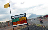 Warning sign realting to the Nyiragongo volcano near Goma which erupted in 2002 resulting in many deaths and displaced many thousands of people from the town. Goma, DR Congo 2004 - Boris Heger - 01-09-2004