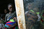 Rwandan refugees returning home under a UNHCR programme arrive at a transit camp to be registered. The majority of the refugees returned in 1996 but some fled attacks and hid in the forest and are onl... - Boris Heger - 01-09-2004