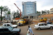 Construction of a new bank in Kigali - investors are returning to put money back into the infrastructure of the country which was much damaged as a result of the 1994 genocide. Rwanda 2004 - Boris Heger - 01-09-2004