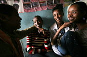 A young Ethiopian woman who has been elected beauty queen at her school, talks with friends about AIDS awareness program in a Youth Association, Dessie, Ethiopia, 2005. - Boris Heger - 30-06-2005