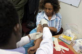 First Lady Azeb Mesfin, wife of Ethiopian Prime Minister Meles Zenawi, gives a blood sample for HIV-AIDS testing, as part of a programme to encourage testing in Ethiopia where HIV transmission is grow... - Boris Heger - /,2000s,2004,Acquired immune,africa,african,Africans,AIDS,blood,Blood Test,deficiency syndrome,developing,disease,DISEASES,east,East Africa,edu,edu education,educate,educating,education,educational,et