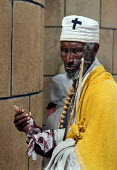 An elderly priest greets some of the hundred thousand pilgrims who walk each December for sixty five kms from the city of Dire Dawa to the Orthodox Church of Saint Gabriel at Kulubi to celebrate Angel... - Boris Heger - &,2000s,2005,africa,african,Africans,age,ageing population,belief,christian,christianity,christians,Church,churches,conviction,developing,east,East Africa,elderly,ethiopia,ethiopian,ethiopians,faith,f
