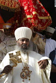 The Head of the Orthodox Chruch greets some of the hundred thousand pilgrims who walk each December for sixty five kms from the city of Dire Dawa to the Orthodox Church of Saint Gabriel at Kulubi to c... - Boris Heger - &,2000s,2005,africa,african,Africans,belief,christian,christianity,christians,Church,churches,conviction,developing,east,East Africa,ethiopia,ethiopian,ethiopians,faith,festival,festivals,GOD,LIFE,mal
