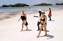 Western tourists with locals on beach, Malindi, Kenya 2005 - Boris Heger - 06-09-2005
