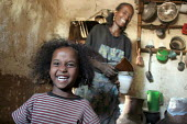 An Ethiopian family in a typical village house, Tigray, Ethiopia 2004 - Boris Heger - 2000s,2005,adult,adults,africa,african,Africans,child,CHILDHOOD,children,developing,east,East Africa,ethiopia,ethiopian,ethiopians,families,family,female,females,girl,girls,house,houses,juvenile,juven