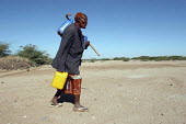 Elderly Somali refugee collecting water, Aisha refugee camp, Ethiopia 2005 The provision of clean drinking water prevents water borne disease. - Boris Heger - 06-09-2005
