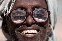 Elderly Somali refugee , Aisha refugee camp, Ethiopia 2005 - Boris Heger - 2000s,2005,africa,african,Africans,age,ageing population,camp,camps,developing,Diaspora,displaced,east,East Africa,elderly,ethiopia,ethiopian,ethiopians,eye,eyes,eyesight,eyesite,foreign,foreigner,for