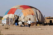 Somali refugees living in traditional tukul tents, Aisha refugee camp, Ethiopia 2005 - Boris Heger - 2000s,2005,africa,african,Africans,camp,camps,child,CHILDHOOD,children,developing,Diaspora,displaced,east,East Africa,EQUALITY,ethiopia,ethiopian,ethiopians,excluded,exclusion,foreign,foreigner,foreig