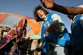 UNHCR aid worker with Somali refugees living in traditional tukul tents, Aisha refugee camp, Ethiopia 2005 - Boris Heger - 2000s,2005,africa,african,Africans,aid agency,aid workers,assistance,camp,camps,developing,Diaspora,displaced,east,East Africa,ethiopia,ethiopian,ethiopians,FEMALE,foreign,foreigner,foreigners,humanit