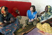 A UNHCR aid worker meets with Somali women who are refugees living in traditional tukul tents, Aisha refugee camp, Ethiopia 2005 - Boris Heger - 06-09-2005