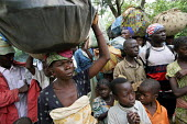Refugees flee across the border from conflict in the Central African Republic ( CAR ) to arrive in Chad where they are assisted by aid workers from UNHCR. Chad 2005 - Boris Heger - 16-09-2005
