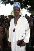 A young refugee with a fake mobile phone and radio among refugees who have fled across the border from conflict in the Central African Republic ( CAR ) arrive in Chad where they are assisted by aid wo... - Boris Heger - 11-11-2005