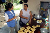 UNHCR workers visit Colombian refugees who received UNHCR microcredits to start their own businesses. Amparo, Venezuela 2004 - Boris Heger - 2000s,2004,Aid Agency,aid workers,america,americas,amerindian,amerindians,armed forces,army,assistance,colombia,Colombian,Diaspora,displaced,FEMALE,foreign,foreigner,foreigners,humanitarian,immigrant,