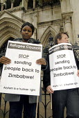 Protest outside the High Court against the Home Office attempts to remove failed Zimbabwean asylum seekers to Zimbabwe. London, UK 2006 - Howard Davies - 2000s,2006,activist,activists,against,Asylum Seeker,Asylum Seeker,BME Black minority ethnic,CAMPAIGN,campaigner,campaigners,CAMPAIGNING,CAMPAIGNS,Court,DEMONSTRATING,DEMONSTRATION,DEMONSTRATIONS,depor