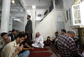 Shijaia. Gaza City. The Palestinian prime minister Ismail Haniya at friday prayer in the Alislah Mosque. Since the Israeli military re entered the Gaza Strip he has had to keep a low profile as he is... - Thomas Morley - 28-07-2006