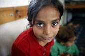 A Palestinian girl shelters in a classroom in a school in Jabalya refugee camp in the Gaza Strip. Over the last two weeks over 500 Palestinian people living in the Gaza Strip, close to the Israeli bor... - Thomas Morley - 29-07-2006