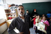 A Palestinian family shelter in a classroom in a school in Jabalya refugee camp in the Gaza Strip after they were forced from their homes by the Israeli military. Over the last two weeks over 500 Pale... - Thomas Morley - 29-07-2006