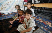 Palestinian children shelter in a classroom in a school in Jabalya refugee camp in the Gaza Strip after they were forced from their homes by the Israeli military. Over the last two weeks over 500 Pale... - Thomas Morley - 29-07-2006