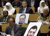 Member of Parliament Mustapha Barghoti sits between two female Hamas ministers at a Palestinian Parliament meeting, Photographs in seats represent candidates imprisoned in Israel. Ramallah, West Bank... - Thomas Morley - 27-03-2006