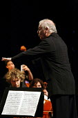 The Israeli Conductor, Daniel Barenboim leads an orchestra of Palestinian musicians in the Ramallah Cultural Palace, to a packed audience. Ramallah, West Bank, Palestine. 2006 - Thomas Morley - 23-04-2006