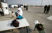 A Palistinian women with permission to visit her husband in prison has her bags checked again after passing through the Israeli side of Eretz check point. Gaza 2006 - Thomas Morley - 23-04-2006