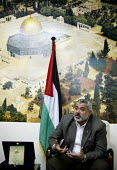 The Palestinian Hamas Prime Minister Ismail Haniya in his office with a copy of the Kuran and a back drop of the Dome Of The Rock. Gaza 2006 - Thomas Morley - 19-04-2006