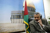 The Palestinian Hamas Prime Minister Ismail Haniya in his office with a back drop of the Dome Of The Rock. Gaza 2006 - Thomas Morley - 19-04-2006