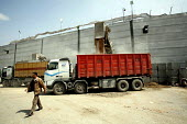 The Karni crossing where Israel controls all commercial goods passing in and out of the Gaza. The Israelis have constructed a system of concrete cells hidden behind bomb proof concrete walls which the... - Thomas Morley - 19-04-2006