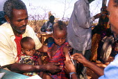 MSF vaccination in drought area on DFID funded programme. Mandera District, Kenya. 2000 - Howard Davies - 03-05-2000