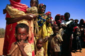 Families queue outside an MSF relief centre established in response to the famine and drought on the northern Kenya - Somalia border. 2000 - Howard Davies - 03-05-2000