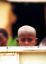 Rwandan refugees returning home across the Rusumo bridge having been refugees in Tanzania for two years. Tanzania - Rwanda border. 1996 - Howard Davies - 03-05-1994