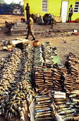 Weapons and ammunition confiscated from Rwanan refugees as they crossed the border into Goma, Zaire - Congo. 1994 - Howard Davies - 03-05-1994