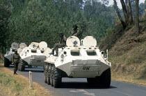 UN tanks on patrol shortly after the Rwandan genocide in south west Rwanda. 1994 - Howard Davies - 03-05-1994