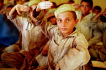 Afghan refugee children at camp school, NWFP Pakistan. 1989 - Howard Davies - 1980s,1989,Afghan,afghanistan,afghans,asia,Asian,asians,camp,camps,child,CHILDHOOD,children,Diaspora,displaced,edu,edu education,educate,educating,education,educational,foreign,foreigner,foreigners,im