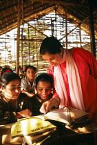 Bhutanese refugee children and teacher at school, Sanischare camp, Nepal. 1997 - Howard Davies - 03-05-1997