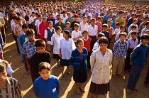 Bhutanese refugee children at school assembly, Beldangi camp, Nepal. 1997 - Howard Davies - 03-05-1997
