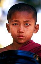 Buddhist boy monk at temple complex, Pagan, Burma. 1996 - Howard Davies - &,1990s,1996,asia,asian,asians,belief,boy,boys,buddha,buddhism,buddhist,buddhists,burma,burmese,child,CHILDHOOD,children,conviction,developing,faith,GOD,juvenile,juveniles,kid,kids,LIFE,male,monk,monk