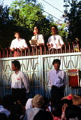 Aung San Suu Kyi speaks to an NLD rally outside her home in Rangoon, Burma. 1996 - Howard Davies - 1990s,1996,asia,asian,asians,burma,burmese,conflict,conflicts,developing,FEMALE,home,myanmar,outside,people,person,persons,political,POLITICIAN,POLITICIANS,politics,rallies,rally,Rangoon,UCW,woman,wom