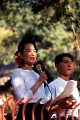 Aung San Suu Kyi speaks to an NLD rally outside her home in Rangoon, Burma. 1996 - Howard Davies - 1990s,1996,activist,activists,asia,asian,asians,burma,burmese,CAMPAIGN,campaigner,campaigners,CAMPAIGNING,CAMPAIGNS,conflict,Conflict Protest,conflicts,DEMONSTRATING,DEMONSTRATION,DEMONSTRATIONS,devel